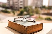 Old Book And Eye Glasses. Flights Of Imagination. Reading, Education, Knowledge And Vision Concept.  poster