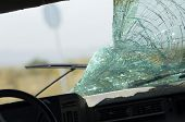 Closeup of a car with broken windshield