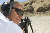 stock photo of shooting-range  - Closeup of a man in shooting position on shooting range - JPG