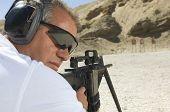 image of shooting-range  - Closeup of a man in shooting position on shooting range - JPG