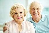 stock photo of sweethearts  - Portrait of smiling seniors enjoying spending time together - JPG