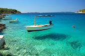 Boat in a quiet bay on Brac island in Croatia