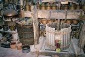 Barrels With Grapes In An Old Monastery.