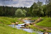 stock photo of loneliness  - Beautiful nature park on a summer day in city of Valmiera Latvia - JPG