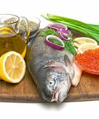 Trout, Caviar, Lemon And Vegetables On A White Background
