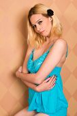 stock photo of nightie  - Pretty blonde woman in a blue nightie - JPG