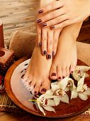 stock photo of toe nail  - Closeup photo of a female feet at spa salon on pedicure procedure - JPG