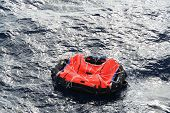 image of safe haven  - Life raft from a ship floating in mid ocean - JPG
