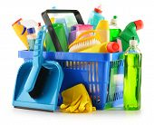 stock photo of detergent  - Shopping basket with detergent bottles and chemical cleaning supplies isolated on white - JPG