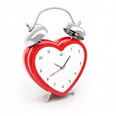 Isolated heart shaped alarm clock on white background