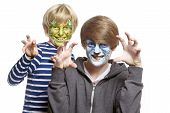 Teenage And Young Boys With Face Painting Monster And Wolf