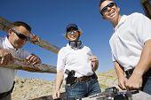stock photo of shooting-range  - Happy troops standing together at shooting range - JPG