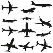 A set of black planes or airplanes flying isolated on white background
