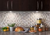 stock photo of granite  - Food ingredients in a contemporary kitchen with cozy lighting - JPG