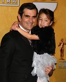 LOS ANGELES - JAN 27:  Ty Burrell, Aubrey Anderson-Emmons pose in the press room at the 2013 Screen
