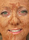 pic of mud pack  - woman with detoxifying mud on her face - JPG