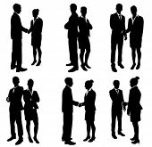 stock photo of handshake  - business people handshake silhouettes collection - JPG