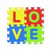 Word LOVE written with alphabet puzzle letters. Vector.