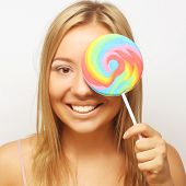 Nice blond girl with lolipop. Closed eye.