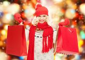 holidays, sale, shopping, christmas concept - beautiful teenage girl in winter clothes with shopping