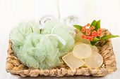 Shower Puff And Soaps In Banana Leaf Basket