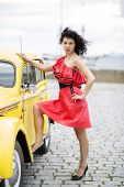 Woman In Dress Rely Leg On Car