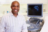 foto of ultrasound machine  - Portrait Of 4D Ultrasound Scanning Machine Operator - JPG