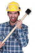 Angry construction worker with a sledgehammer