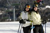 Two Beautiful Girls Skiing Together
