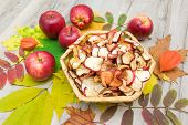 Fresh And Dried Apples On Autumn Leaves