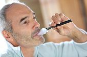 Portrait of senior smoker with electronic cigarette