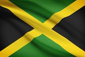 foto of jamaican  - Jamaican flag blowing in the wind - JPG