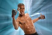 African American mixed martial arts fighter over abstract background