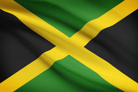 stock photo of jamaican flag  - Jamaican flag blowing in the wind - JPG