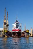 stock photo of shipyard  - A large cargo ship is being renovated in shipyard Gdansk Poland - JPG