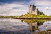 stock photo of galway  - Dunguaire Castle, reflected in the calm sea, in the town of Kinvara, County Galway, Ireland