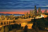 image of washington skyline  - Seattle Washington City Skyline with Freeway Light Trails After Sunset
