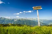 picture of trailblazer  - Tourist paths directions and travel time shown on a traditional direction signs at the Dolomites mountains - JPG