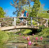 Beautiful romantic couple on bridge over the river with lotus , Cambodia.