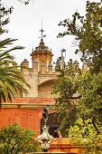 Church Steeples Statue Garden Alcazar Royal Palace Seville Spain