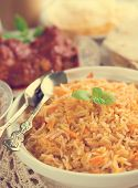 Indian cuisine biryani rice and chicken curry with retro effect.