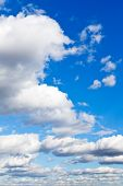 Many Furry White Clouds In Blue Sky poster
