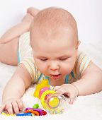 Baby boy playing with a teething toy