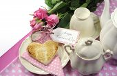stock photo of bed breakfast  - Pink theme Happy Mothers Day breakfast in bed with tea cup and tea pot roses and heart shape toast with white copy space for your text here - JPG