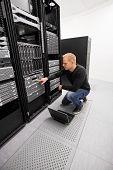 It engineer working in datacenter