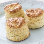 Homemade buttermilk tea biscuits on a pretty plate.