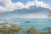 NANTOU, TAIWAN - FEBRUARY 20 : Many tourist people take a trip by boats at the lake of famous attrac