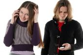 Young Woman Is Talking Gossip And Secret By Mobile Phone Near Her Boyfriend