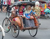 YOGYAKARTA, INDONESIA - AUGUST 03: Traditional rikshaw transport on streets of Yogyakarta, Java, Ind