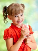 image of schoolgirls  - Schoolgirl portrait with water glass outdoor - JPG